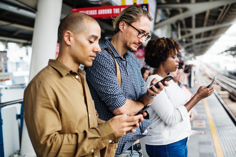 Millennials looking at their phones
